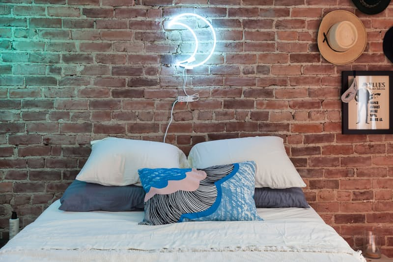 Neon-crescent-moon-and-a-brick-wall-